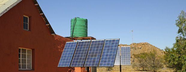 [Translate to English:] Solar panels in front of rural buildings