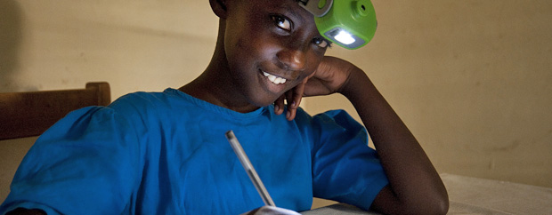 Boy with headlamp doing homework